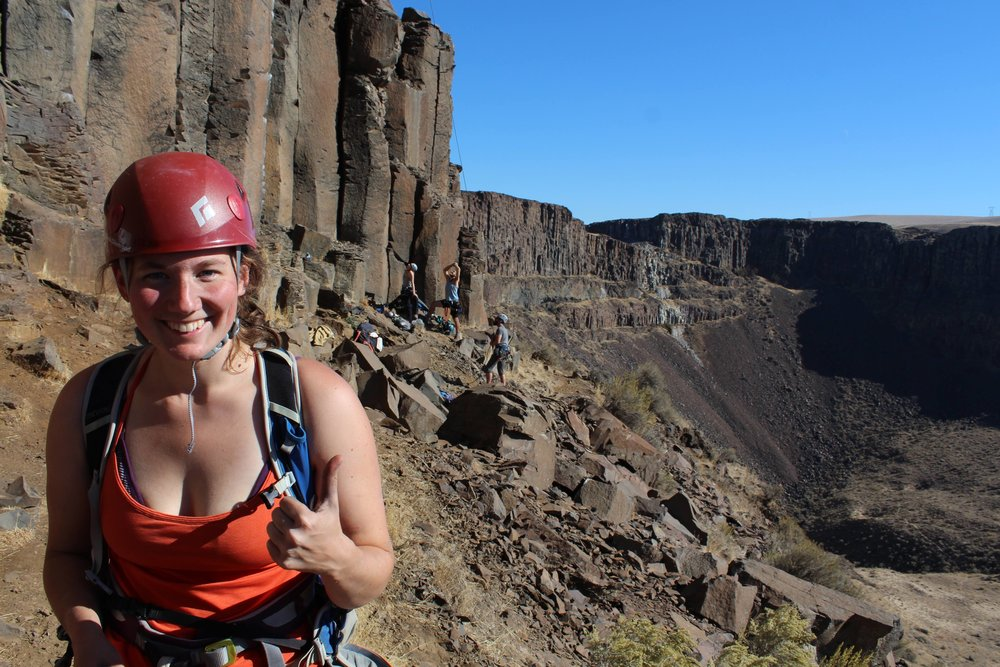 Claire looking awesome posing in front of the tall walls at Vantage, WA!