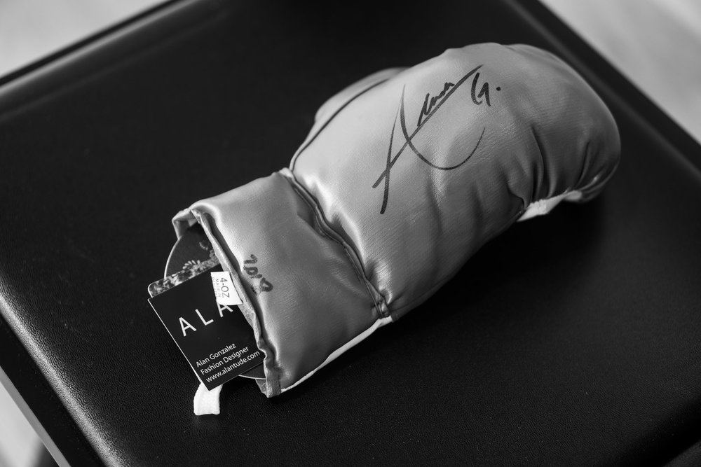 Alan had these autographed boxing gloves on all the seats.