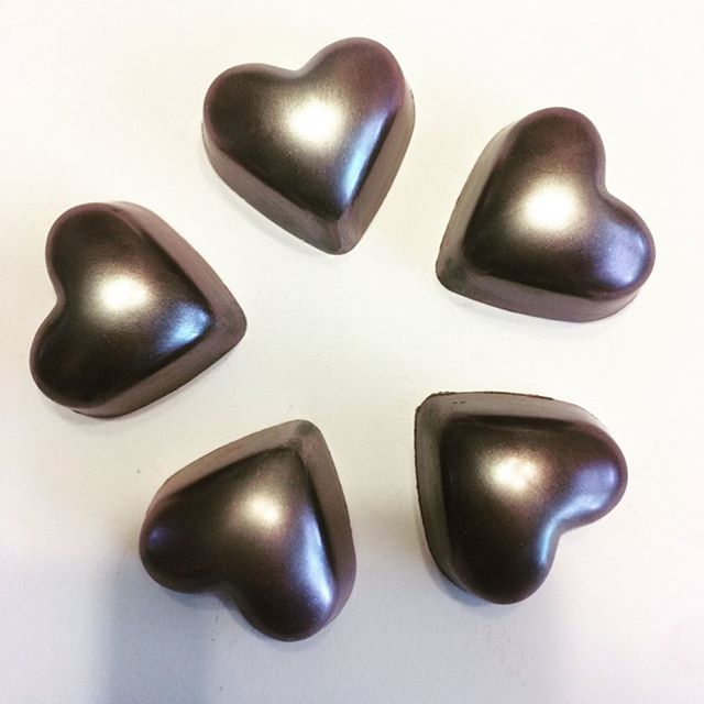 Our dark chocolate port truffles got a little make over for the month of February! Silver hearts anyone?