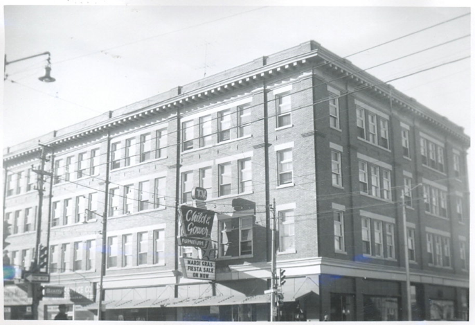 Donahue Building: Home to several successful businesses including Child and Gower Furniture pictured here.  A Child and Gower ad is still visible today on the north side of the Donahue Building.