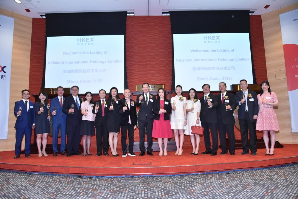 Caption: Mr. Lee Ching Yiu, Chairman and Chief Executive Officer of Kidsland International (8th from right), Dr. Lo Wing Yan William, Vice-Chairman, Chief Financial Officer and Managing Director in Hong Kong (8th from left), Ms. Zhong Mei, Managing Director China (7th from left), management and guests of Kidsland International attended the listing ceremony this morning.