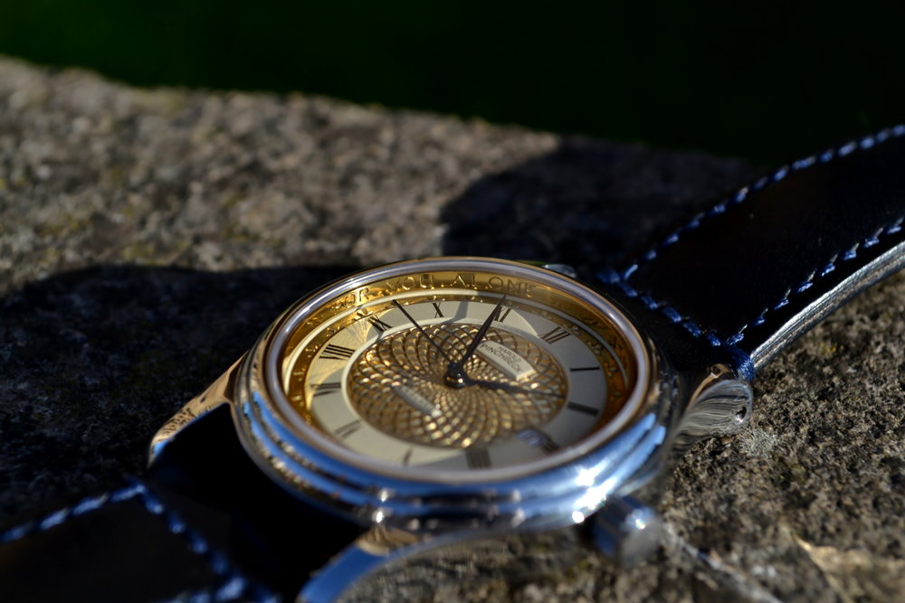 The infinity dial, classic bezel, and Tanner Bates custom leather strap