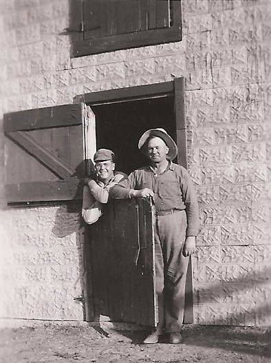 I always liked this photo My dad and his dad. The barn was built around 1927 and is still in use everyday.