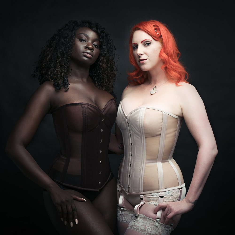 Standard Fit Corsetry - Dark Garden's standard fit corsets fit like no other, because they are based on decades of experience with custom work. We have fabrications for every aesthetic: classic Signature Collection, our new Naturals line, glamorous Risqué mesh corsets, masculine Tailored Cinchers, and charming Dollymops are all available in standard fit sizes 18-38