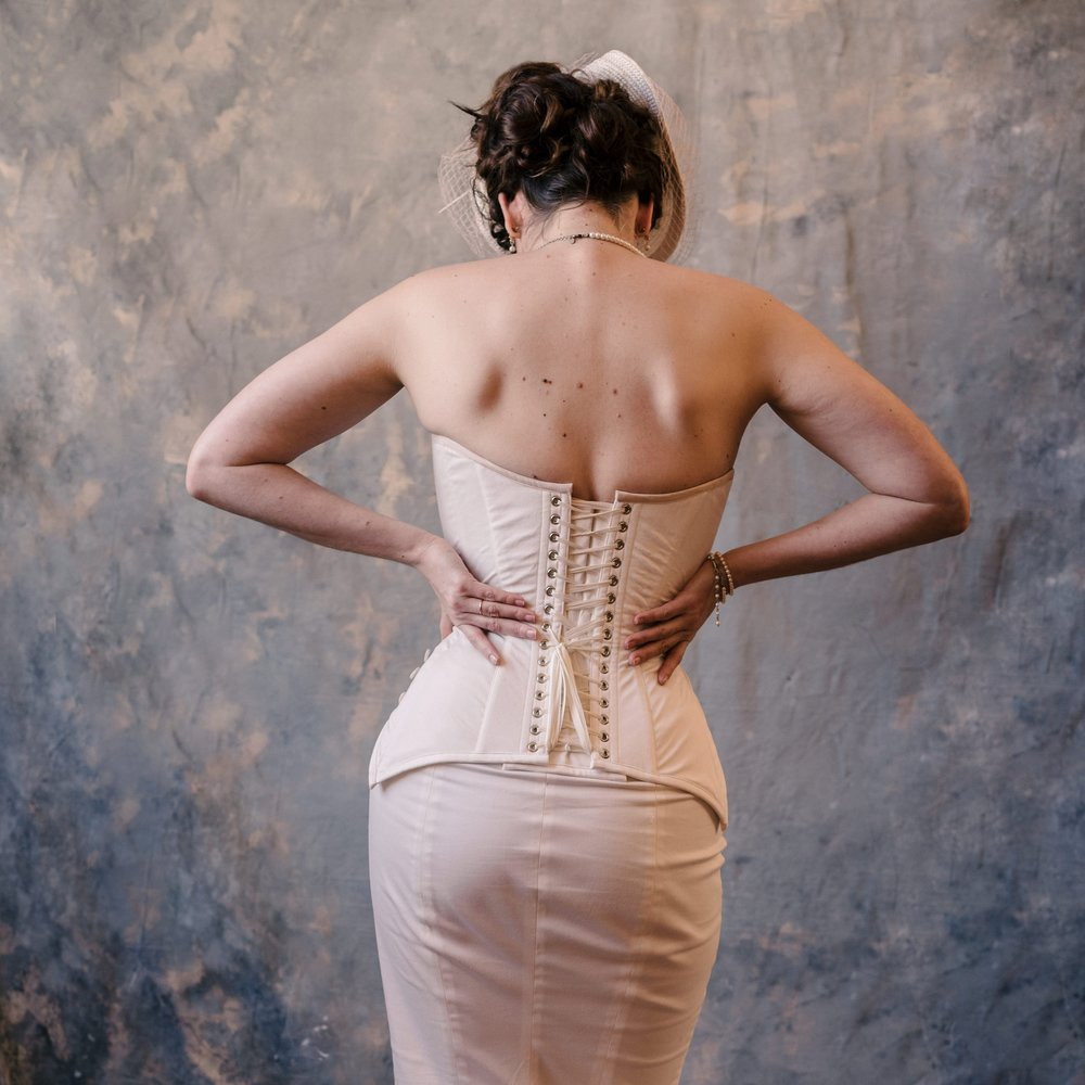 Bespoke Corsetry - Our roots are in bespoke work: each corset completely custom fit. Every dimension, line, and seam is fine tuned for your body and your style. From cupped lingerie corsets to dapper tailored styles and tightlaced leather hobble dresses, we've done it all. Our process and talented team means that we are always able to accept new commissions.