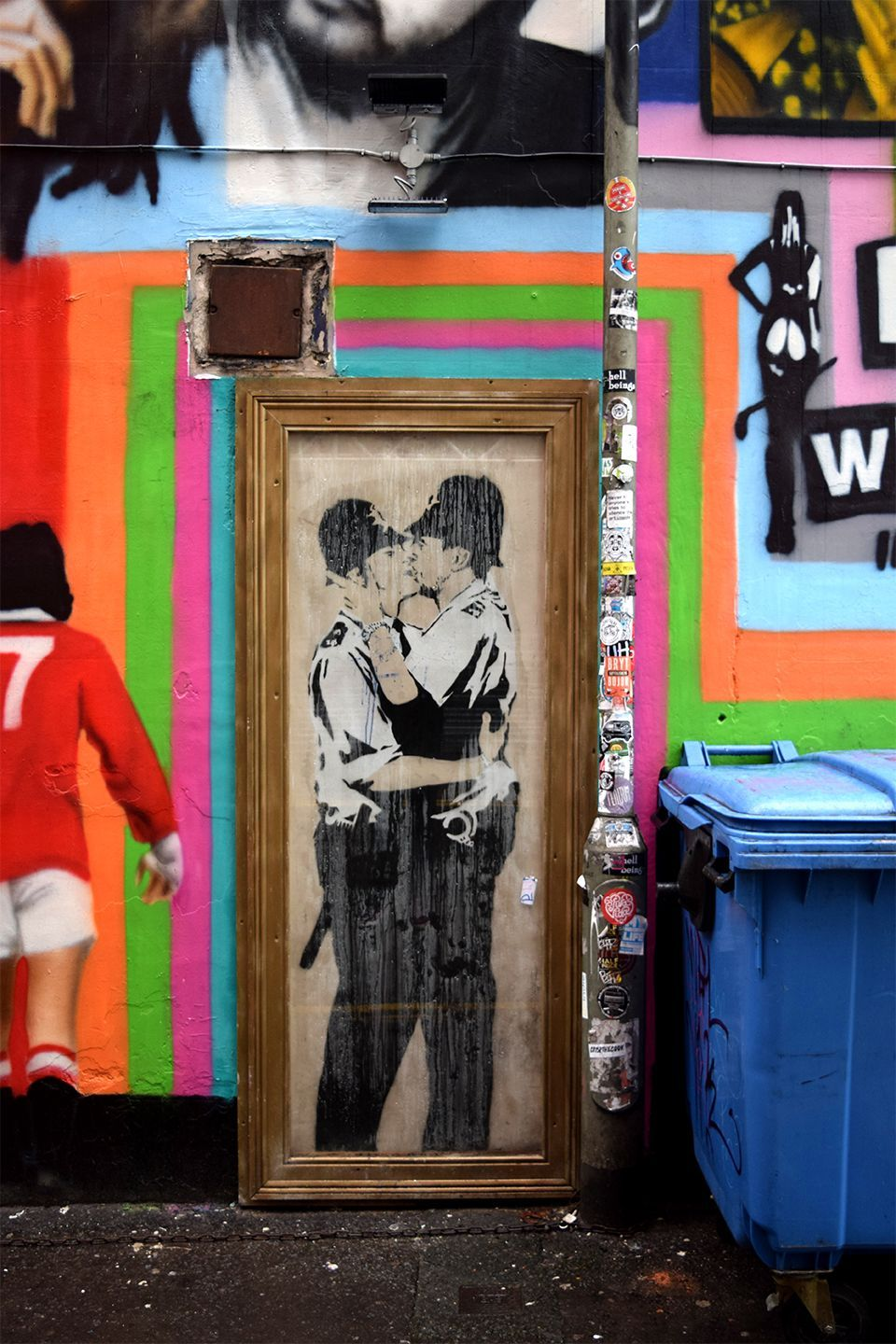 Above image;    Banksy's 'The Kissing Coppers'