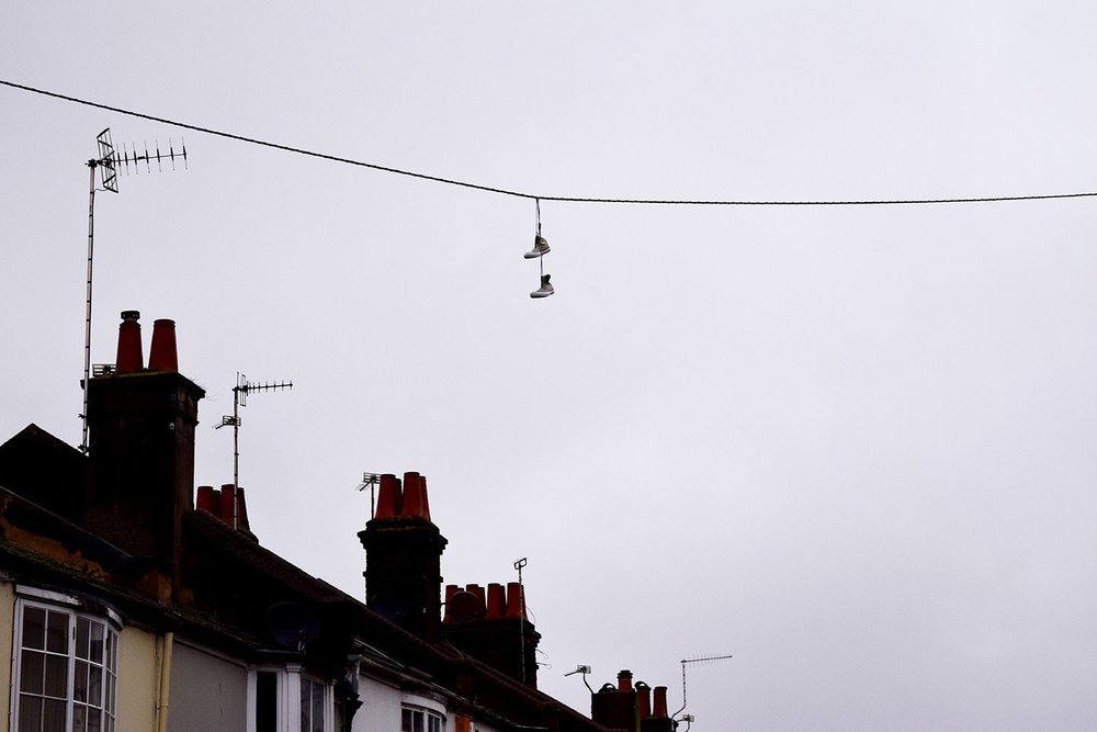 Above image;    Shoes over an electric cable on my street. Somebody marking their territory?