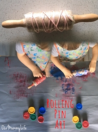Rolling Pin Art    Here is different way to play with the always popular finger paint! Cover a small rolling pin in plastic wrap, then add any texture you prefer or have available. I used string first, then transportation stencils. Other great options are thick stickers, rubber bands, or bubble wrap.  After the pin is covered, let child paint the pin or you can pour the paint in a shallow dish for dipping.  Then, let the good times ROLL!!  **** Be sure to use washable paint as this project can get messy!****