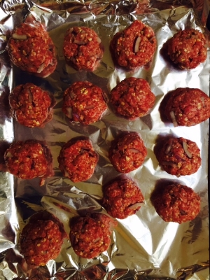 Meatballs rolled & on tray ready to bake