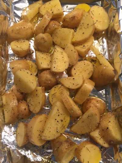 Potatoes cut up, spiced & ready to bake