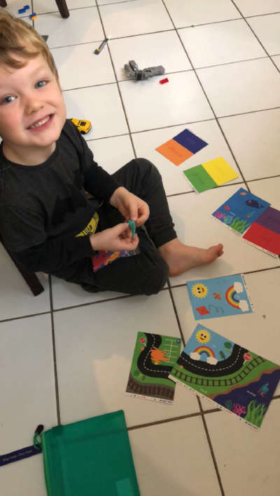 Lucas busy matching colourful transport items to their cards