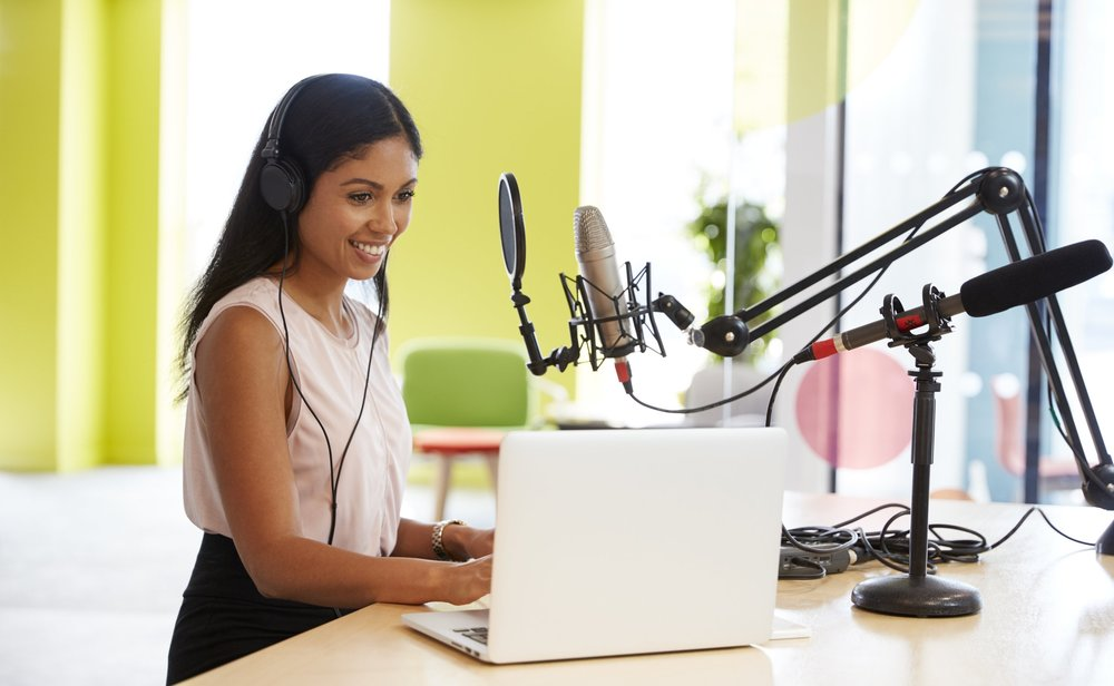 young-mixed-race-woman-recording-a-podcast-in-a-PF85ADU.jpg