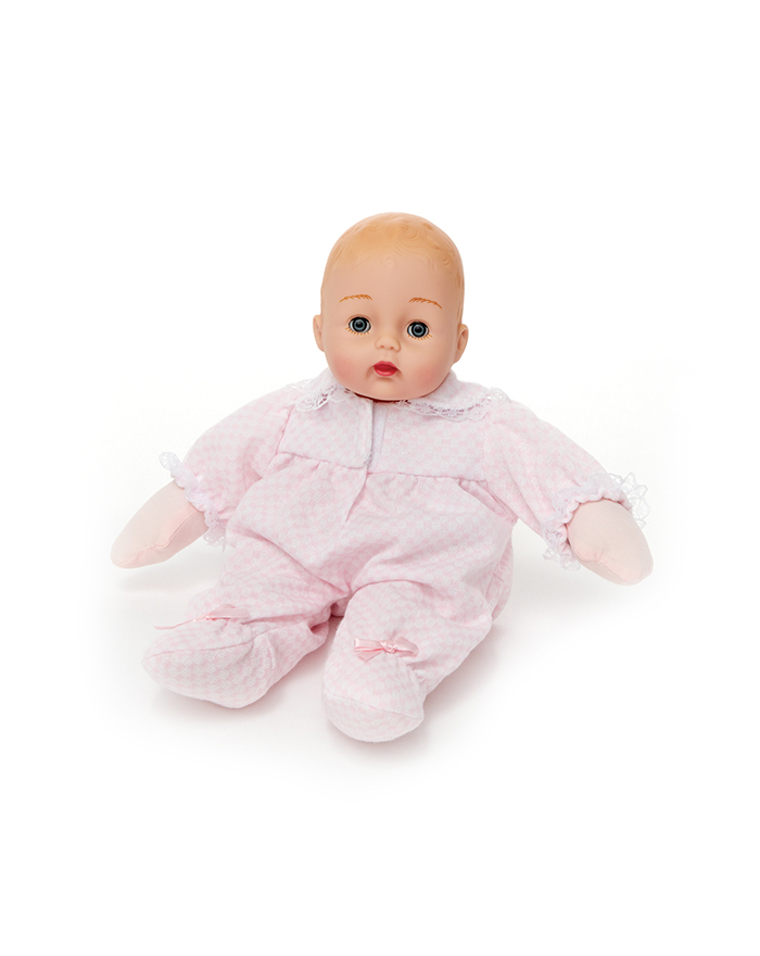 """HUGGUMS - These classic 12"""" baby dolls are perfect for tiny hands. Made with soft bodies meant to be hugged, these dolls are recommended for ages 2+. This adorable dolly will become your """"baby's baby."""""""