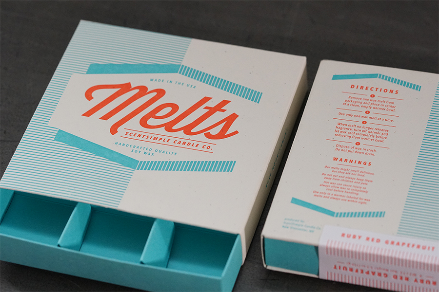 studio-on-fire-melts-letterpress-packaging-tray-peek.jpg