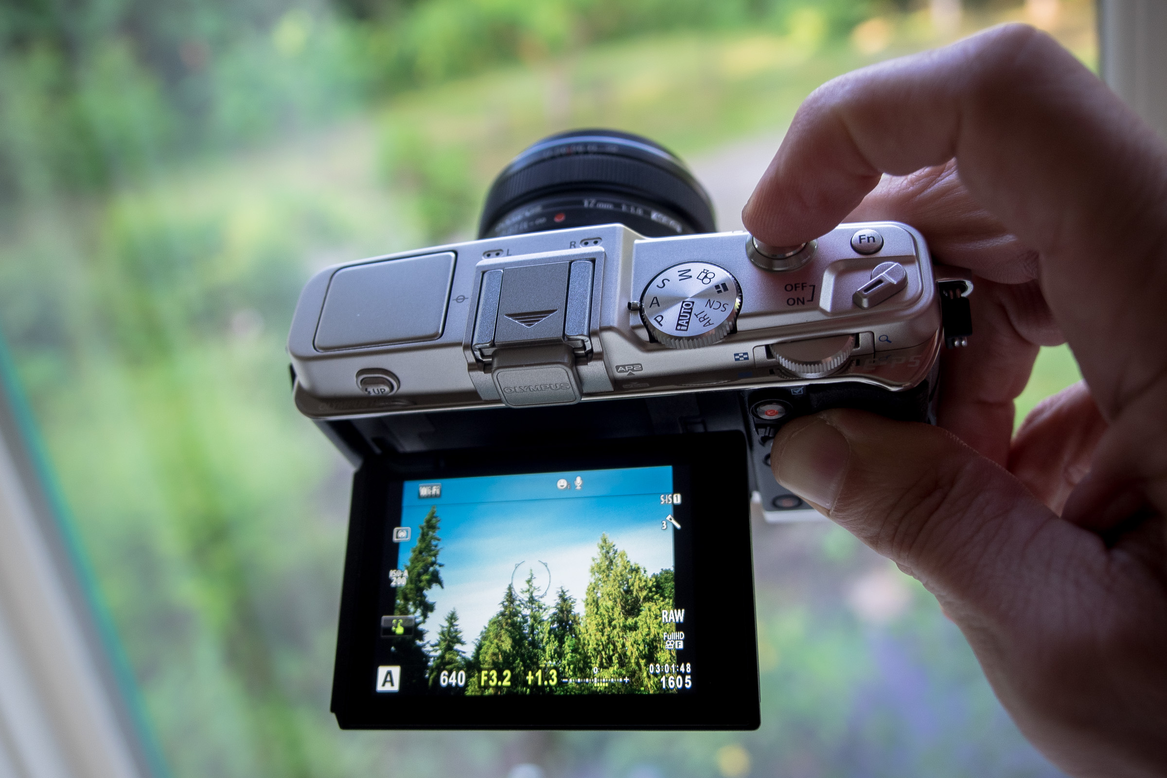 This pocketable camera - an Olympus Pen - has a 16 megapixel sensor, can shoot 8 frames per second at up to 1/8000 second, records professional quality video, and can stream photos directly to a smart phone.