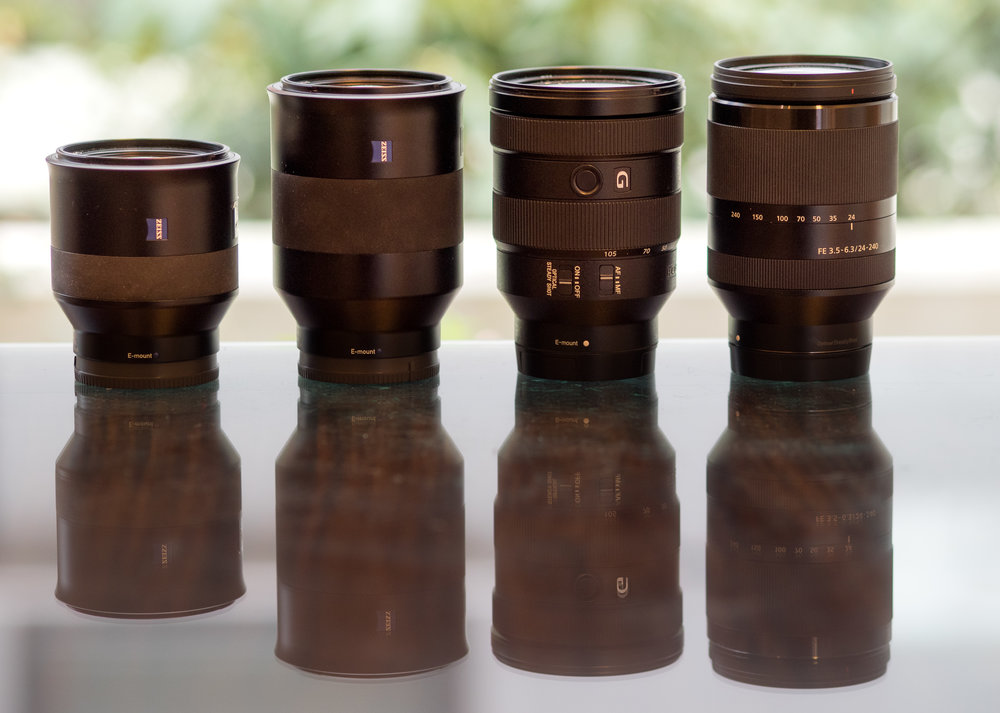 L to R: Batis 1.8/85, Batis 2.8/135, f4/24-105 G, f3.5-6.3/24-240 (taken with Olympus 75mm f/1.8)