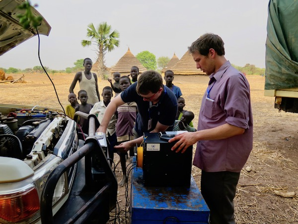Andrew and Ben in S.Sudan powering 3D printer off of car