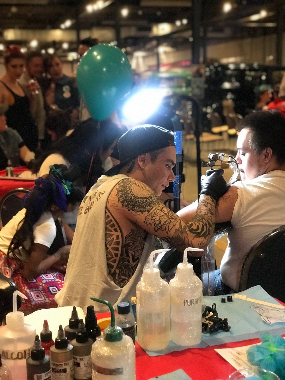 01 Justin Tattooing 1.JPG