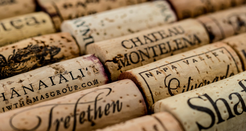 Musings by the Glass - Cork vs Screw Cap - Corks in a Row