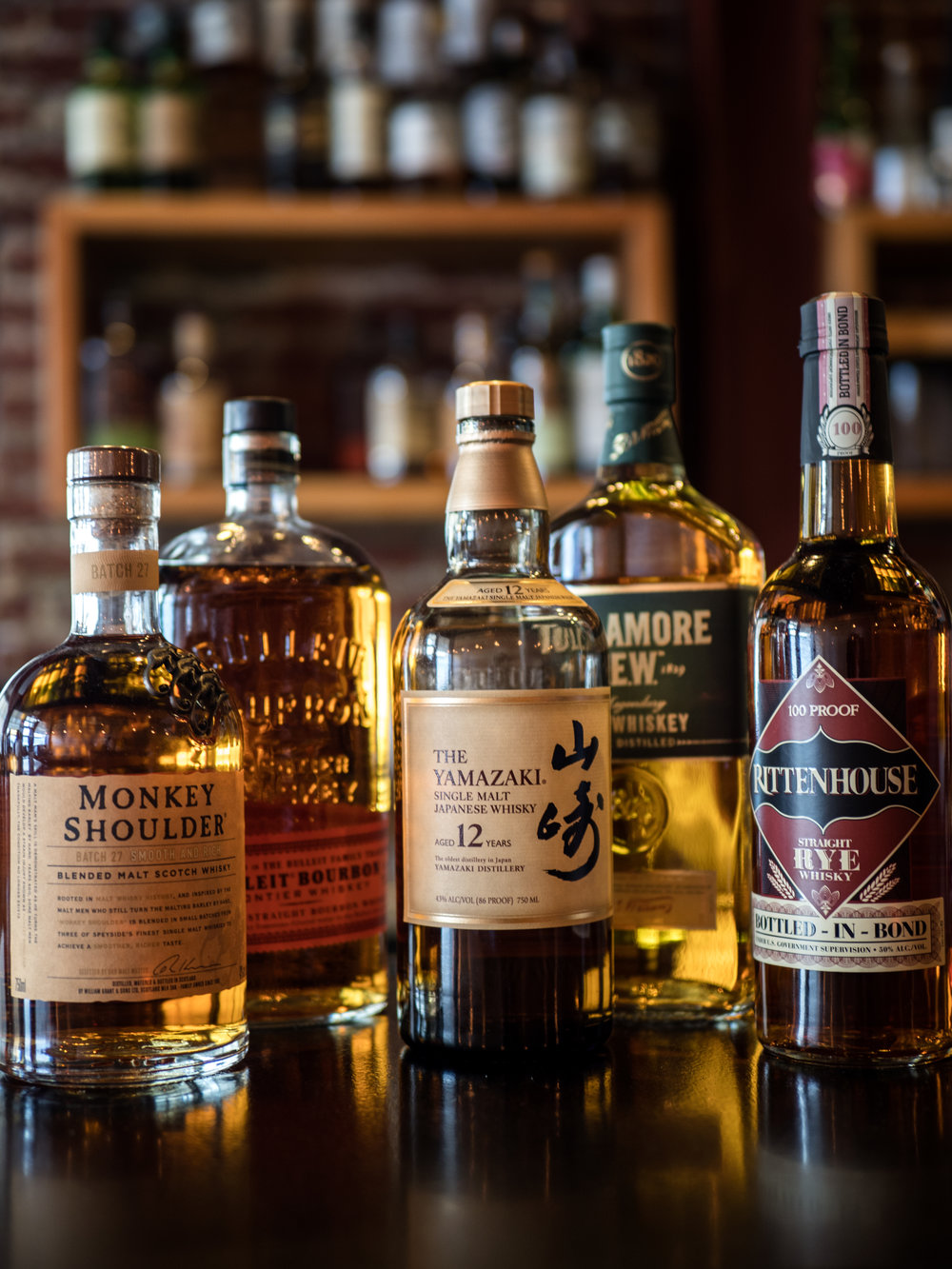 Musings by the Glass - Autumn Whiskey Primer - Whiskey Bottles on Bar