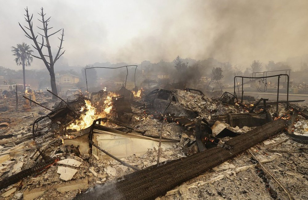 From the Washington Post: Flames rise from the remains of a house that burned down in Santa Rosa. (Jeff Chiu/AP)