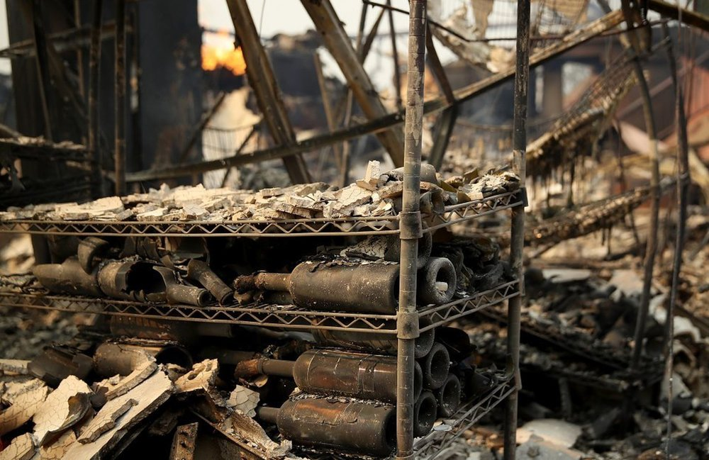 From the Washington Post: Burned out wine bottles sit on a rack at the fire-damaged Signorello Estate winery in Napa. (Justin Sullivan/Getty Images)