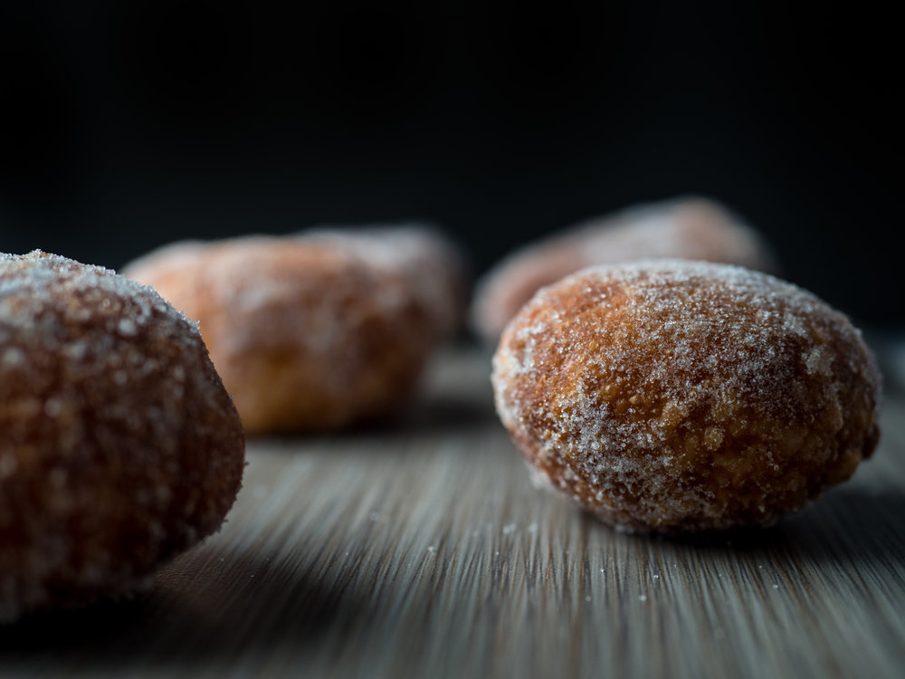 Musings by the Glass - Eggnog and Malasadas - Malasadas in a Row
