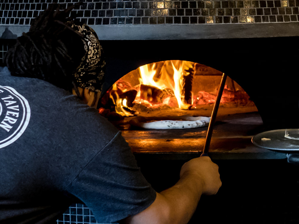 Musings by the Glass - Pizza and Wine Pairing Expansion - Cooking Pizza at Brick Fire Oven in Honolulu