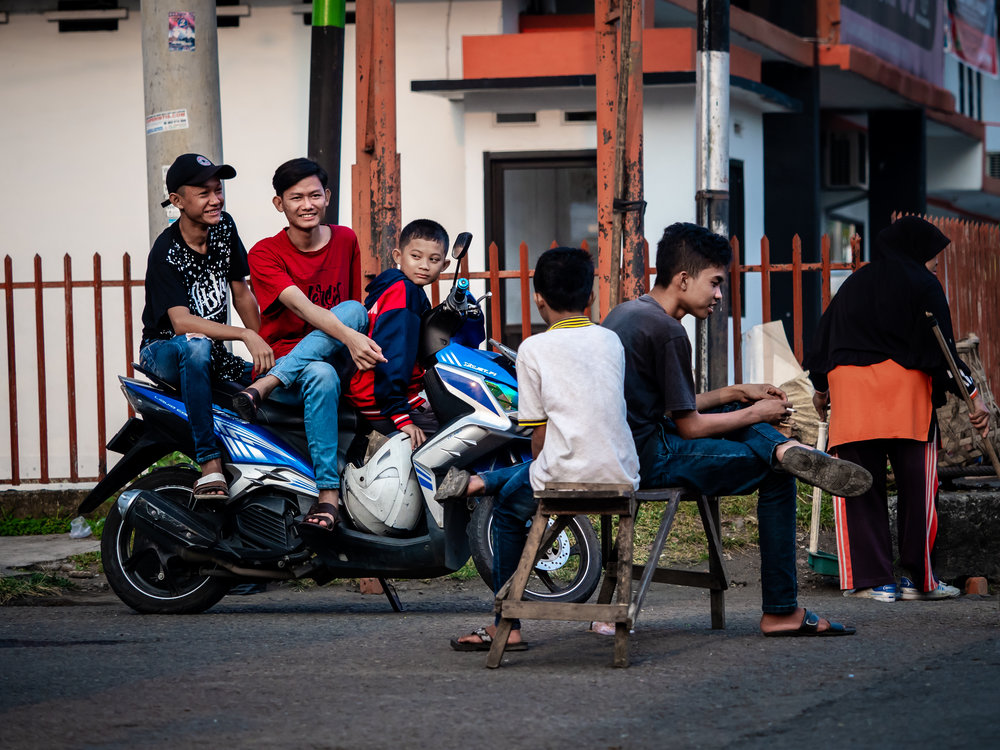 Musings by the Glass - Sumatran Sojourn - Boys on the Street in Lubuklinggau