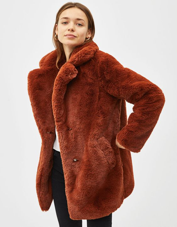 2.  Bershka Long faux fur coat with lapel collar  - $119