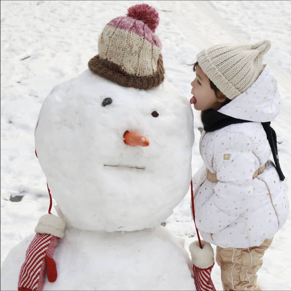Kid and snowman outdoor fun.png