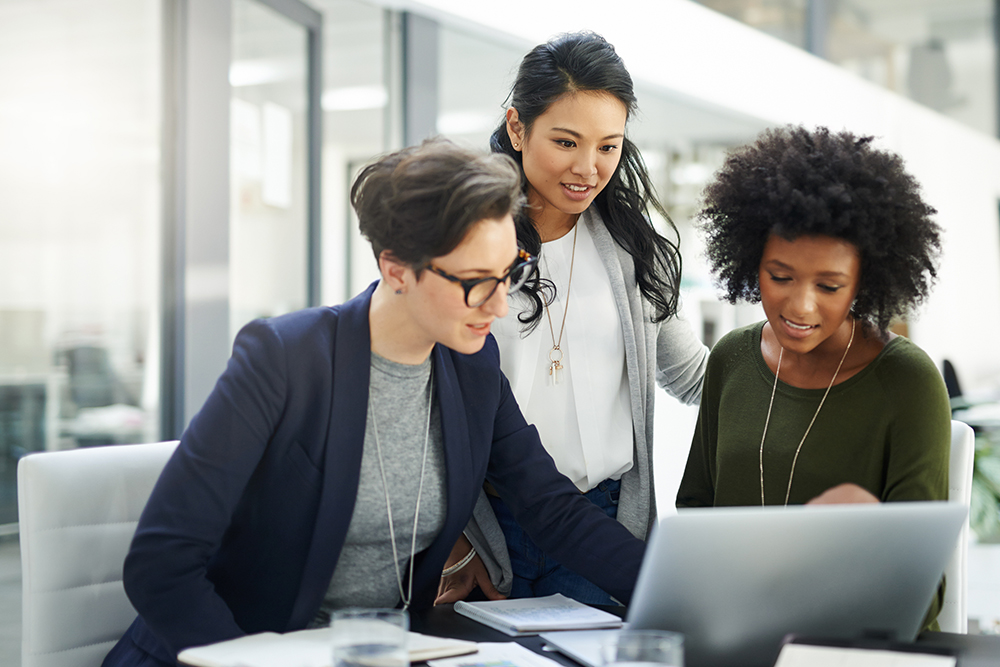 three-women-focused-around-computer-iStock-612854434.jpg