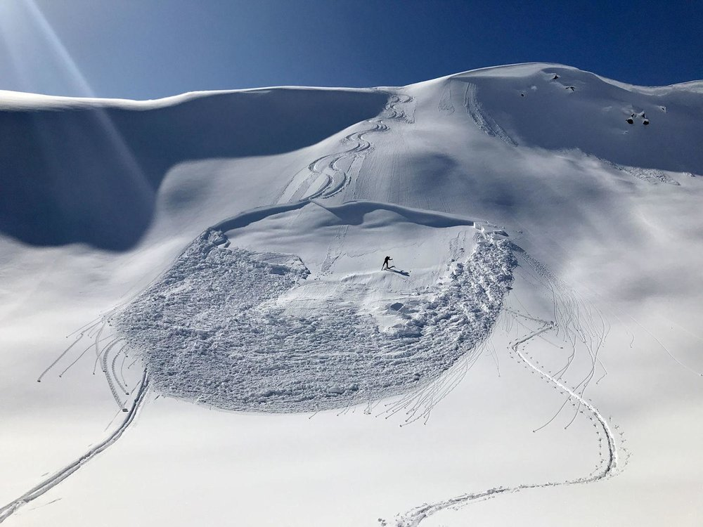 A skier goes back to figure out what went wrong. This avalanche in British Columbia was triggered by the second skier. The group knew there was potential instability but underestimated its sensitivity in their desire to ski the line. No one was buried in the slide. Photo: Jackson Hole News & Guide.