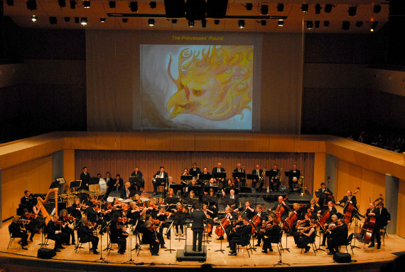 APO at V. Sue Cleveland High School, playing Stravinsky's Firebird Suite in 2013. The firebird above the orchestra was painted by student artist Amy Baumann. Photo Credit: Irene Fertik.