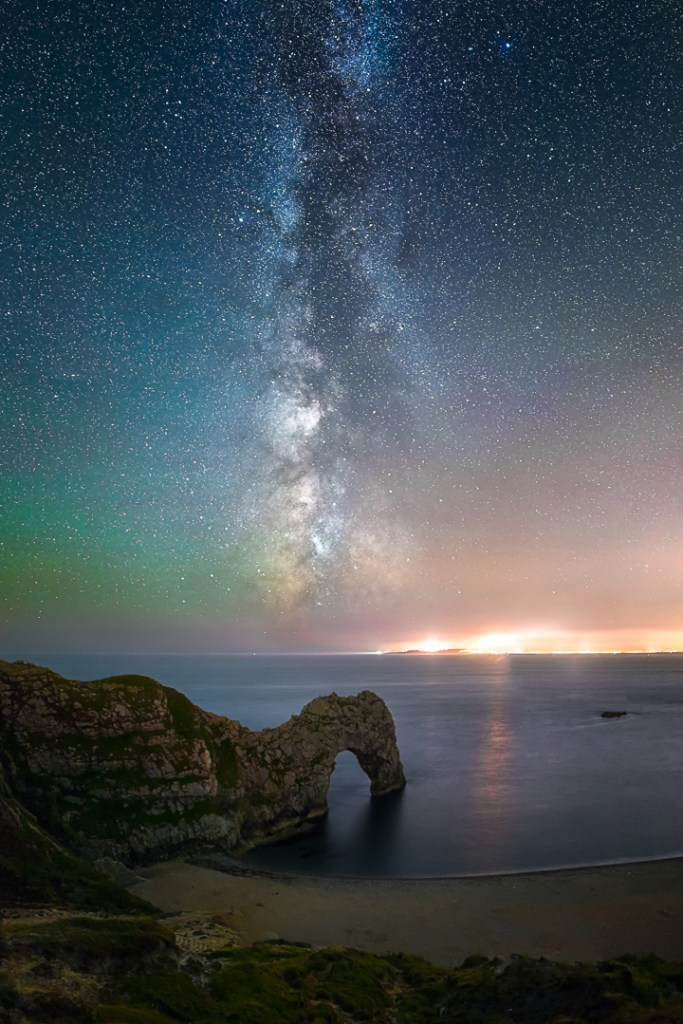 The Milky Way and a display of green airglow above Durdle Door
