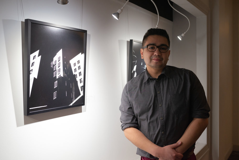 Joshua Seriñana, portrait in front of work