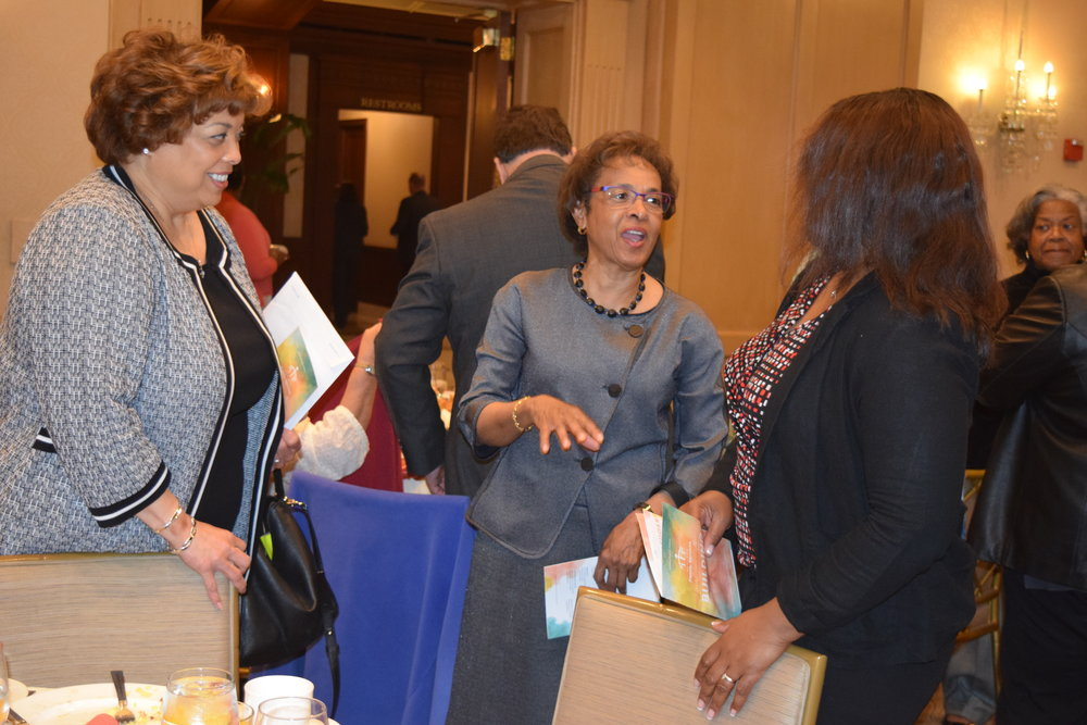 Board member Joya Shepard engages with other guests at the breakfast.