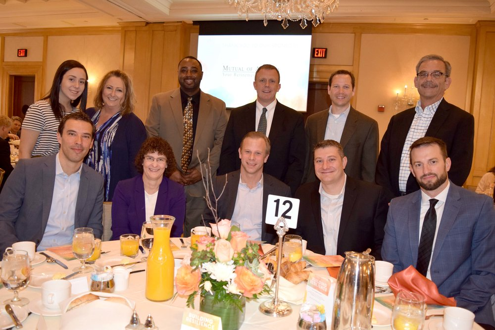 Board member JD Carlson and his guests sit at a table sponsored by  Penske Automotive Group .