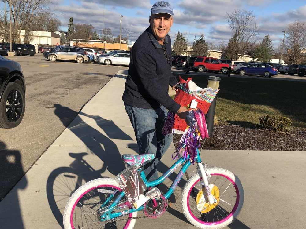 Volunteer Pat McCarty delivers a new bike.