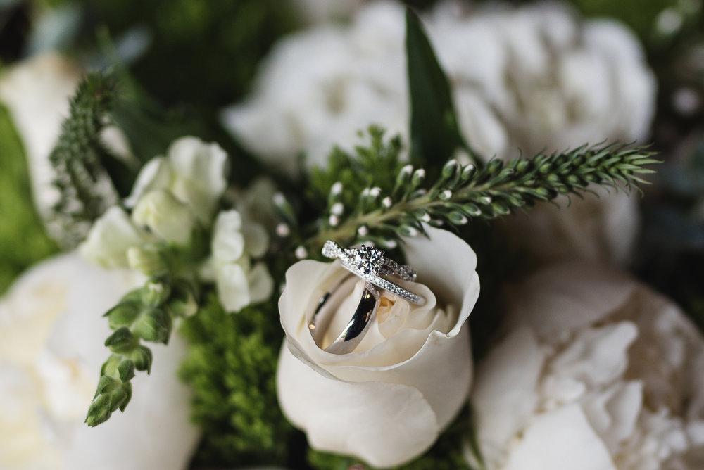 Wedding rings on flower bouquet