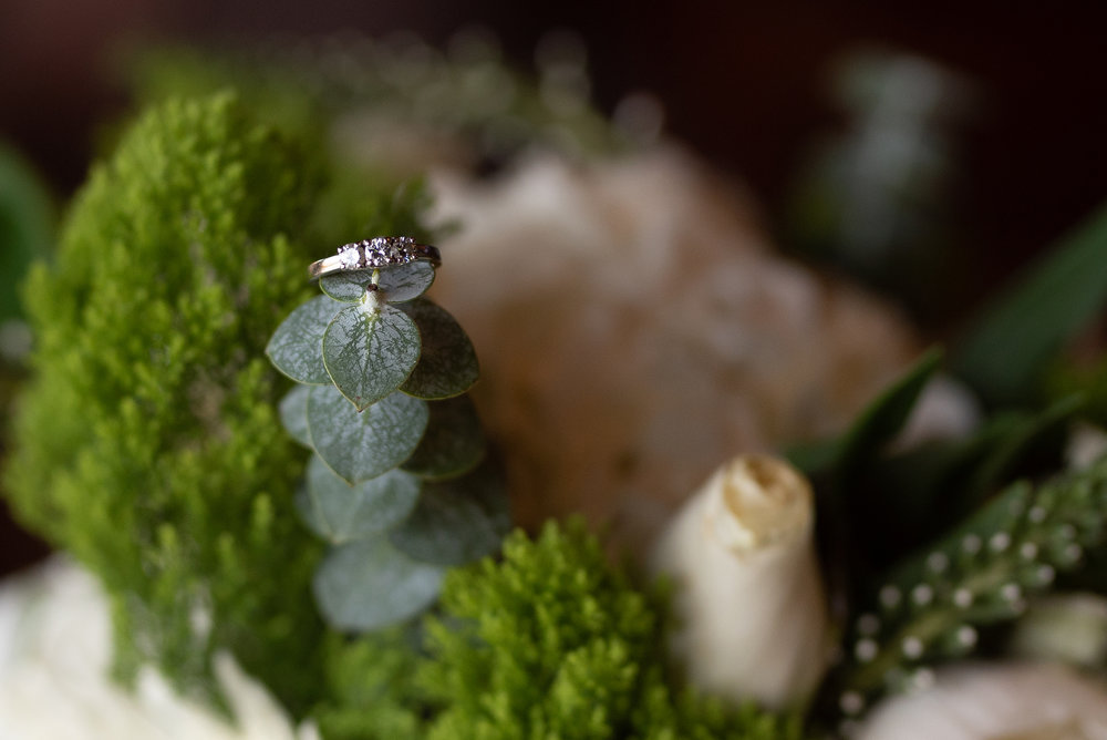 Bride ring on bouquet at wedding at Trout Club