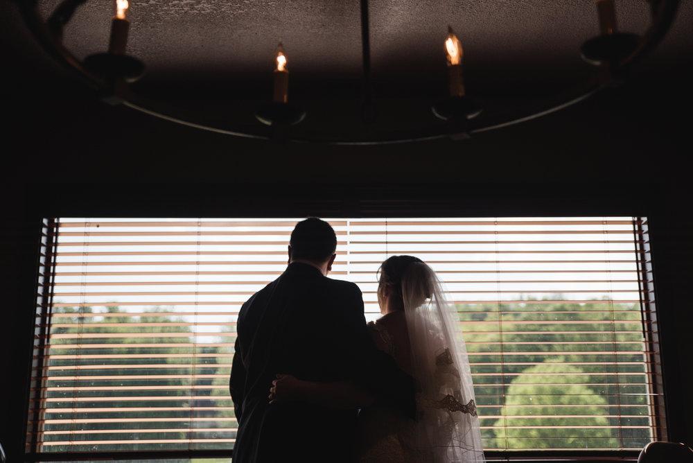 bride and groom rainy day portrait