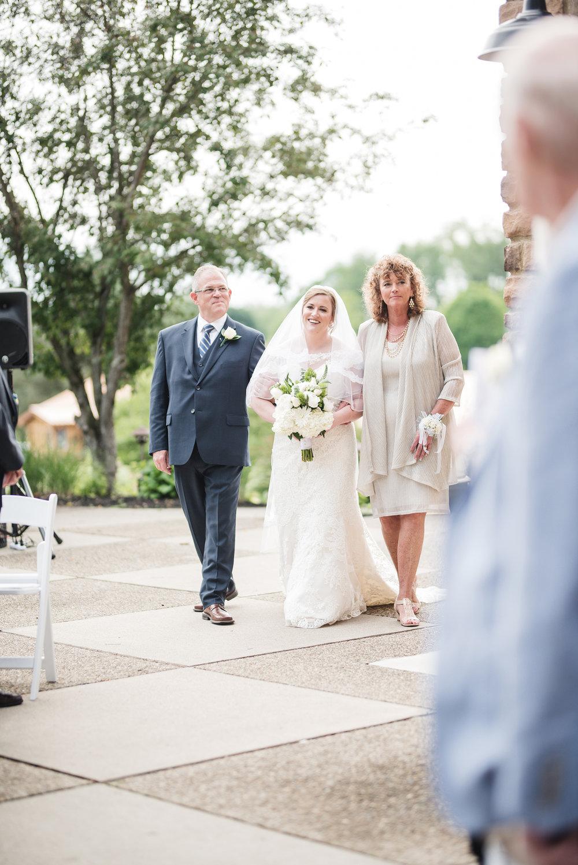 bride walking down aisle at trout club