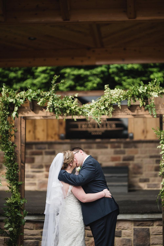 columbus wedding photographer kiss at ceremony