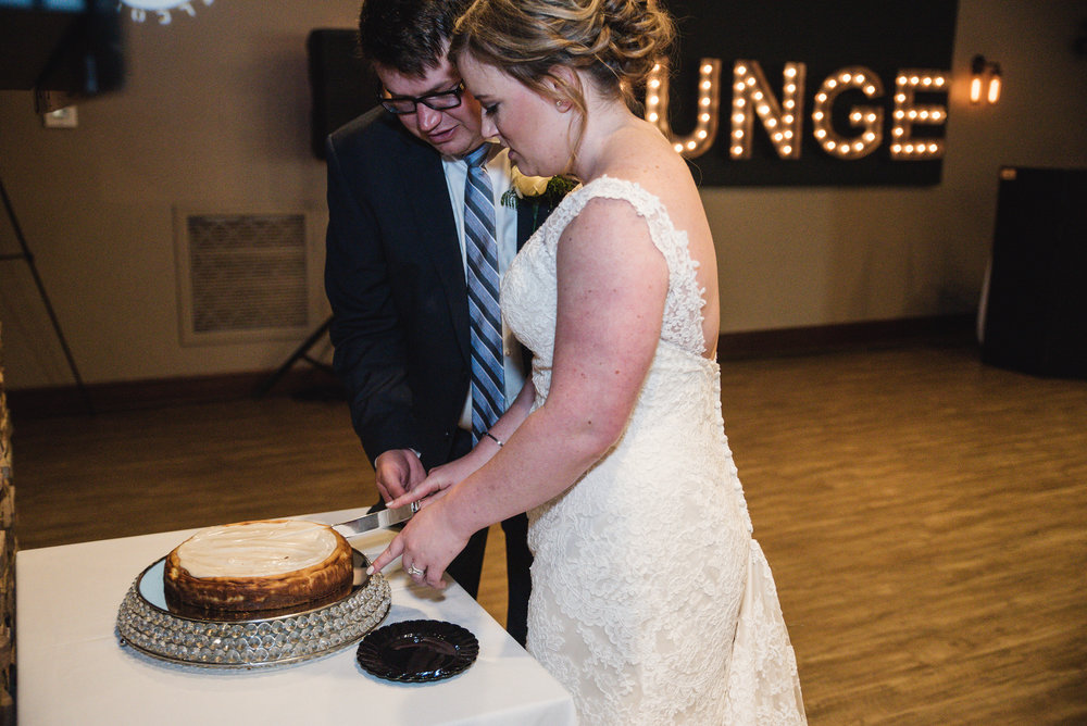 couple cutting their cake at their reception
