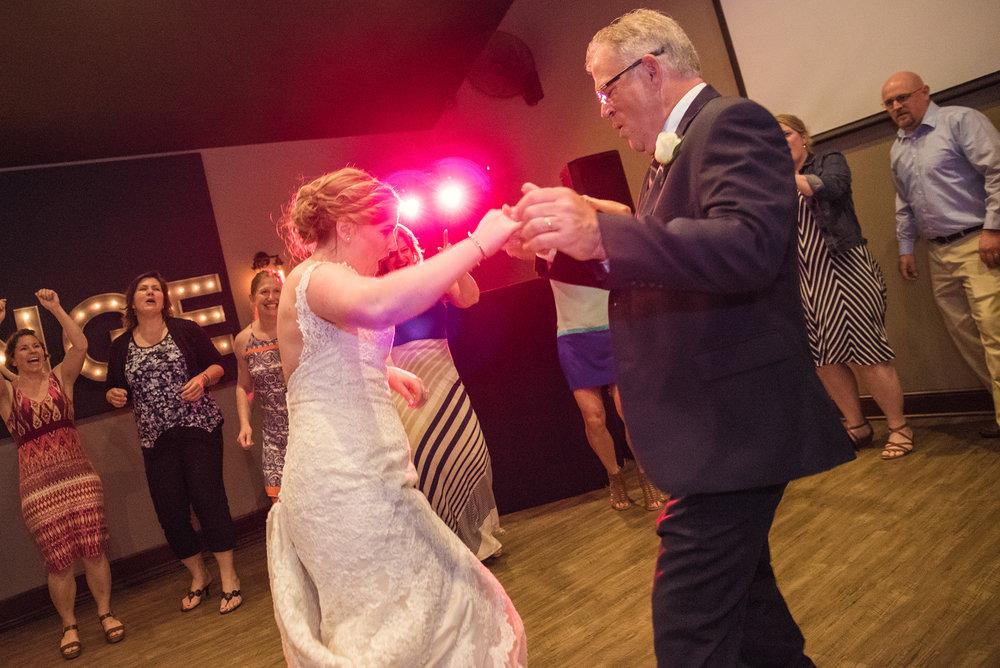 bride dancing with dad at reception