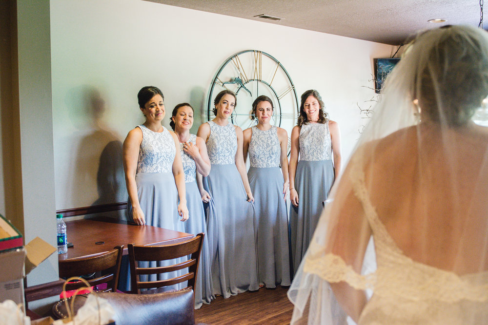 bride first look with bridesmaids
