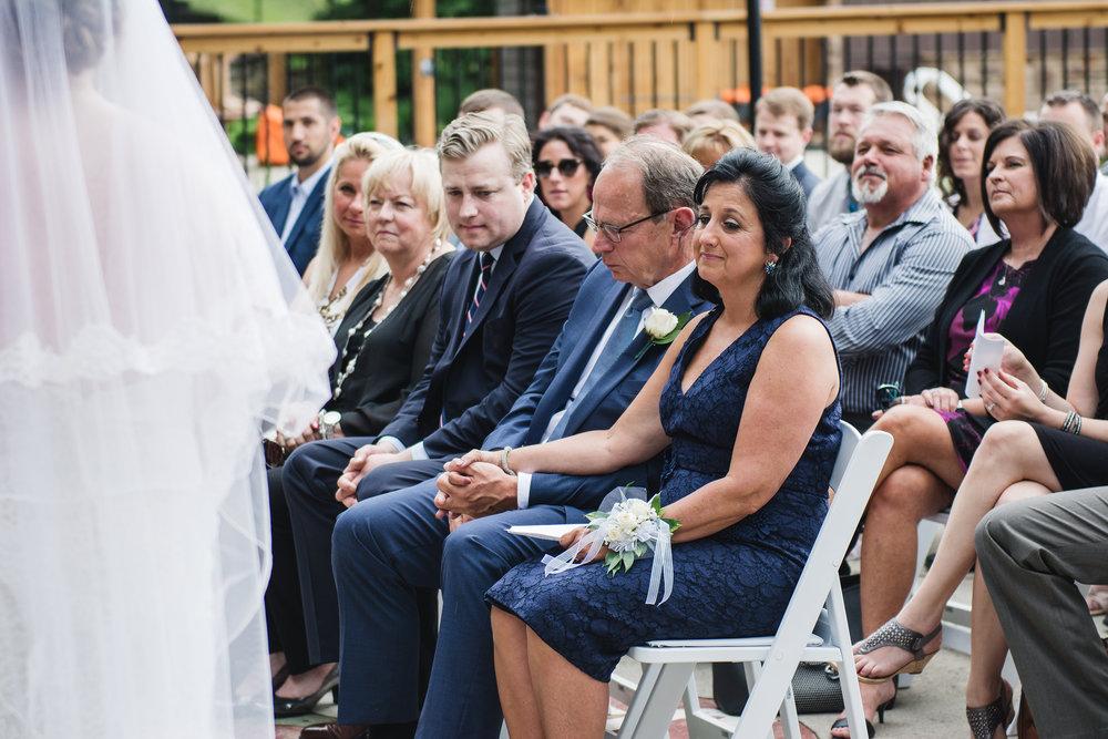Groom's parents watch wedding ceremony