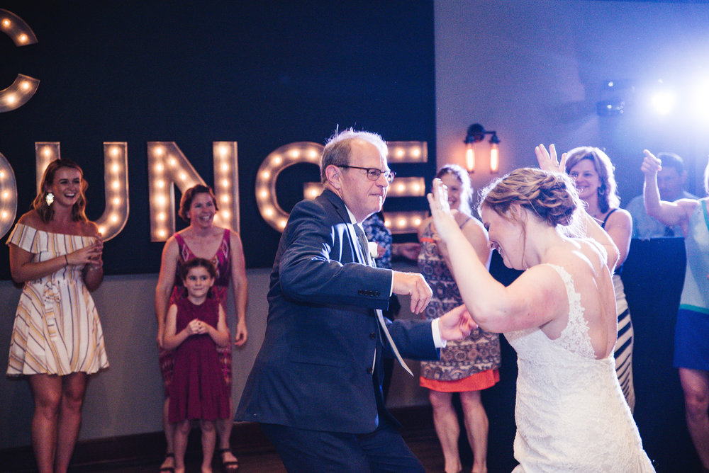 bride and father in law dancing at reception