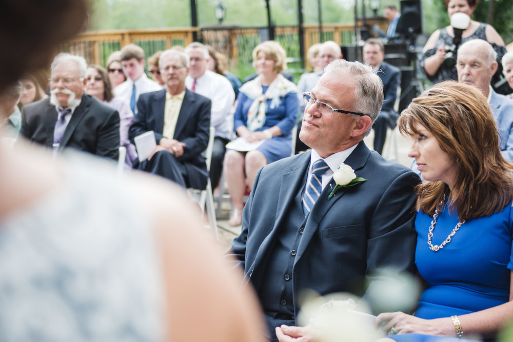 bride's parents watch wedding ceremony